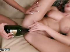 Lesbians stick a champagne bottle in their cunts