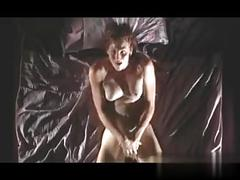 Brunette with big tits fingering her pussy in lingerie