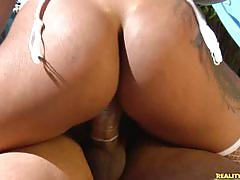 Latina in stockings fucking a cock near the pool.