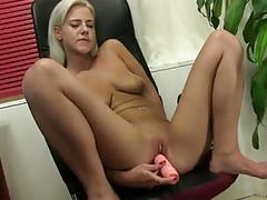 Blonde sex kitten shows off her tight tanned body.