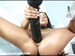 Euro brunette masturbating with giant dildo