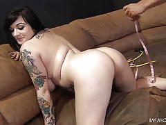 Busty tattooed brunette gets fucked