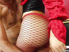 Sexy shemale in red fishnets has some action