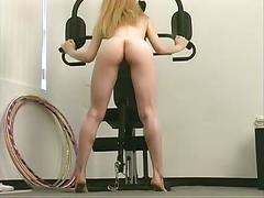 Sexy brunette does sexy workout at gym