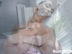 Busty buffy gives her big puppies an oil massage
