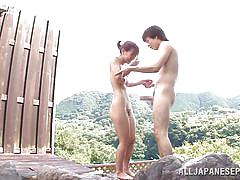 Nippon beauty sucks cock in onsen