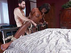 Submissive ebony chick is tied to the bed