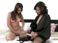 Two lesbians playing with huge strapon dildo