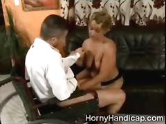 Mature cripple takes off her leg to blow a young studs cock