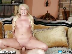 Blonde teen rides her coach's hard cock