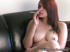 Busty redhead babe smoking during an interview