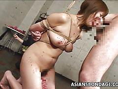 Asian girl is tied up and made to suck cock