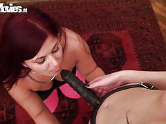 Lesbians have fun with strap on dildo