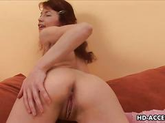 Redhead pigtailed aicha fucks her pussy with dildo