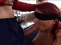 Cute redhead with blindfold gets threesome