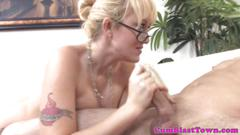 Spex milf gets bukkake drenched after handjob