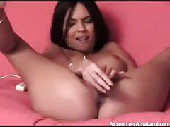 Brunette chick playing with her pussy