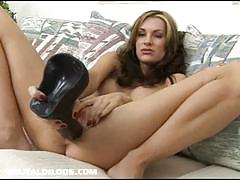 Brandi tries a big and a bigger dildo