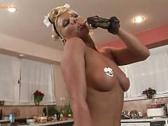 Busty blonde babe strips and masturbates in solo.