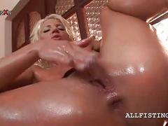 Oily blonde hooker fisting herself hard on a chair
