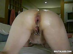 Pierced slut gets her tight ass brutally fisted
