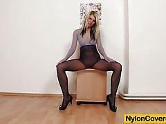 Nylon covered kelly candy playing with fat dildo.
