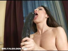 European brunette uses huge black dildo