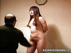 Asian slut has electrodes put on her