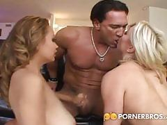Blonde and brunette take turns riding a cock