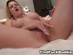 Hot blonde with big tits masturbates on the bed for you
