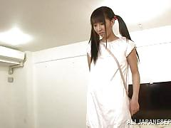Yuuki shows off her shaved pussy