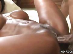 Stunning busty ebony rides a black cock