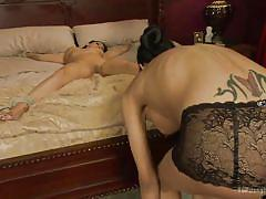 Beauty tied on the bed and fucked by a tranny
