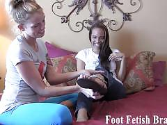 Gorgeous college sluts lick their sexy feet