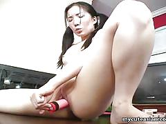 Tiny asian fucks her cunt deeply