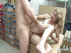 Horny milf takes a break from work and fucks in the warehouse