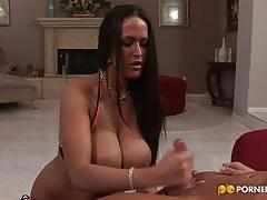 Carmella bing makes a guy cum on her huge boobs