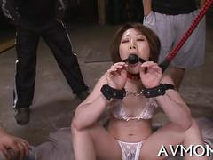 With a gag ball in her mouth shes sexually treated