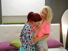 Blonde and redhead make out