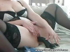 Check my milf - dressed in fishnets and riding dildo