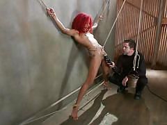 Dungeon master ties up daisy with rope and uses sex toy