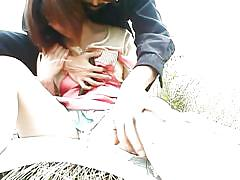 Young japanese girl has sex in a field