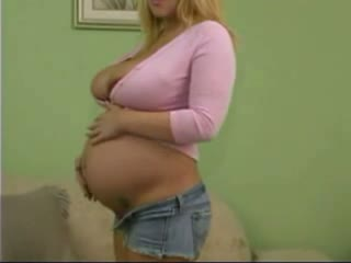 Pregnant blonde toys her twat