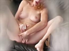 Voyeur view of redhead masturbating