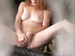 Voyeur view of redhead masturbating