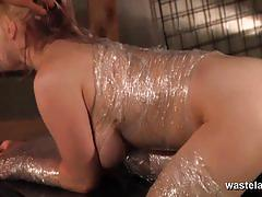 Blonde suspended and wrapped in clingfilm for sex.