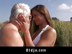 Busty teeny gets fucked by a old dude on the beach