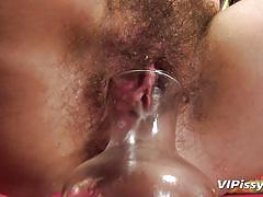 Hairy pussy chick pisses a lot
