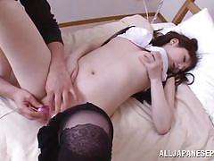 Japanese lady with shaved cunt masturbates