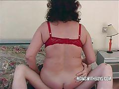 Hot brunette milf in stockings enjoys a young cock